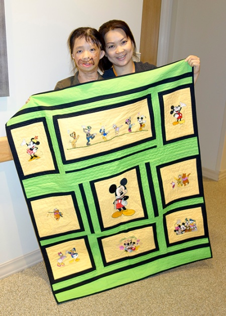 Boun Lod and Noi with blanket made by Annette